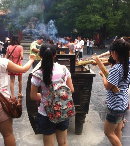 People burning incense.