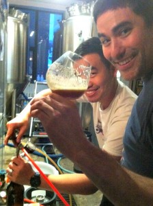 Alex is holding the glass and Kris is doing the bottling.