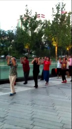 A group of about 20 people walking and getting their daily exercise.