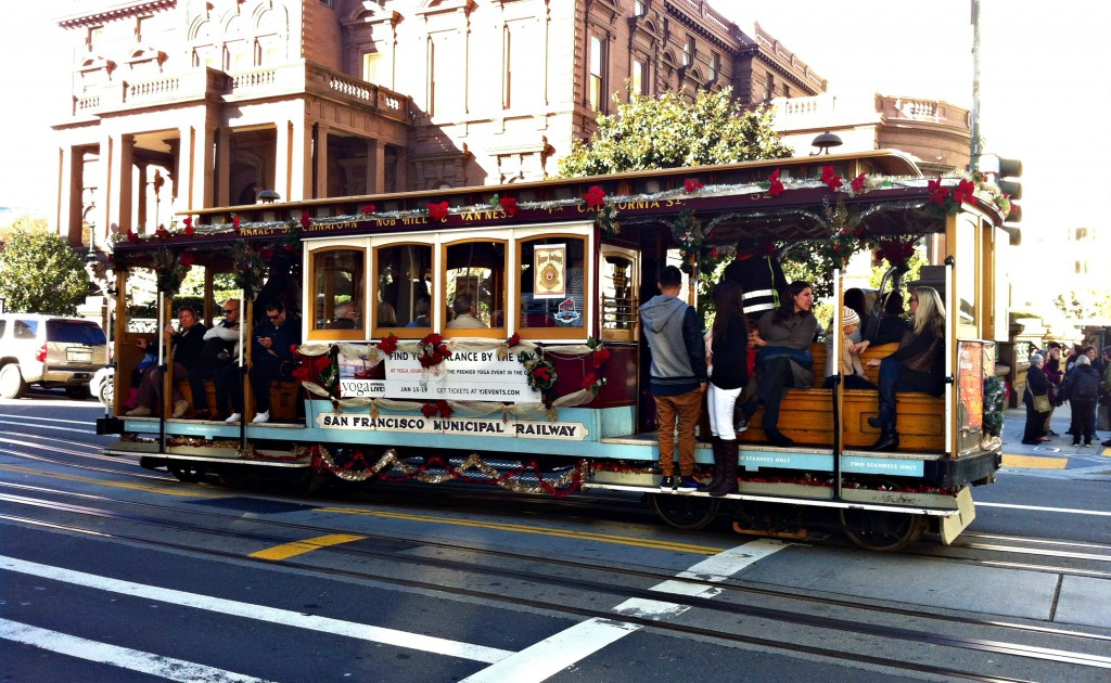 A cable car making a stop on Nob Hill.