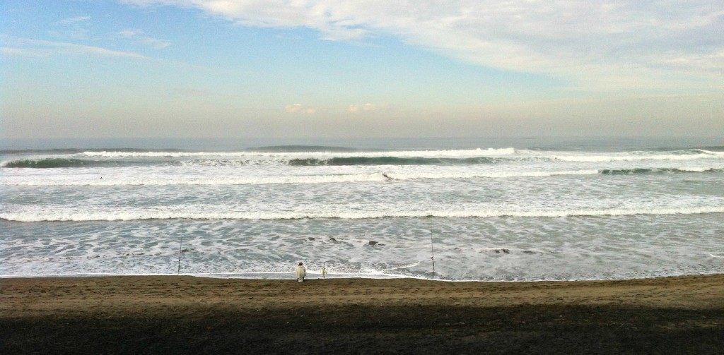 A fisherman waits for his catch of the day at Ocean Beach.