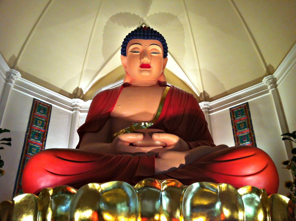 A close up of the Giant Buddha on the second level of the Hua Zang Si Buddhist Temple.